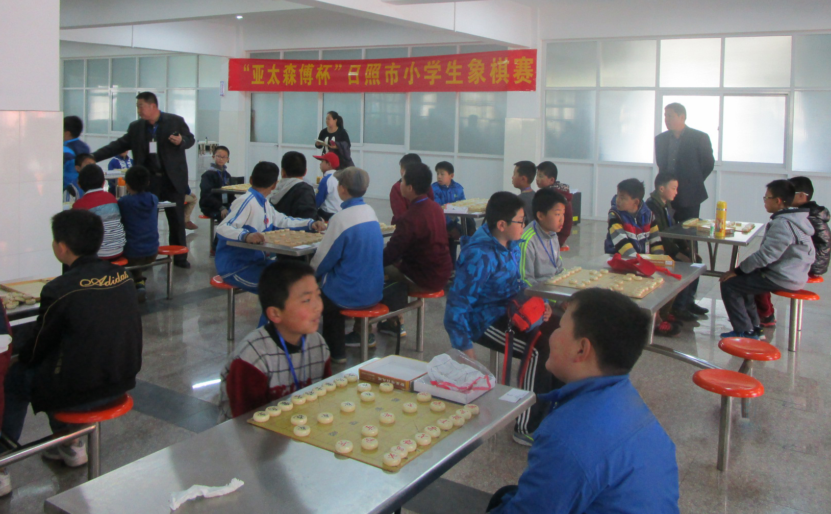 Students challenging one another at the Asia Symbol Chinese Chess Competition