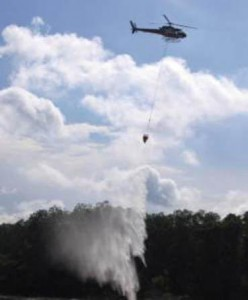 A helicopter performing water bombing.