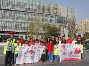 Asia Symbol staff from its Shandong-based pulp and paperboard plant walked side-by-side 14 excited and energetic children along the Rizhao river