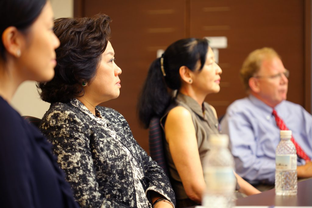 Tanoto Foundation Co-Founder Tinah Bingei Tanoto and Board of Trustees Member Belinda Tanoto listen as SingHealth Duke-NUS professors explain the impact of the gift to catalyse drug and vaccine discovery
