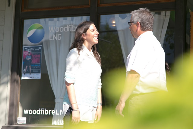 Residents chat outside the Woodfibre LNG community office in Squamish