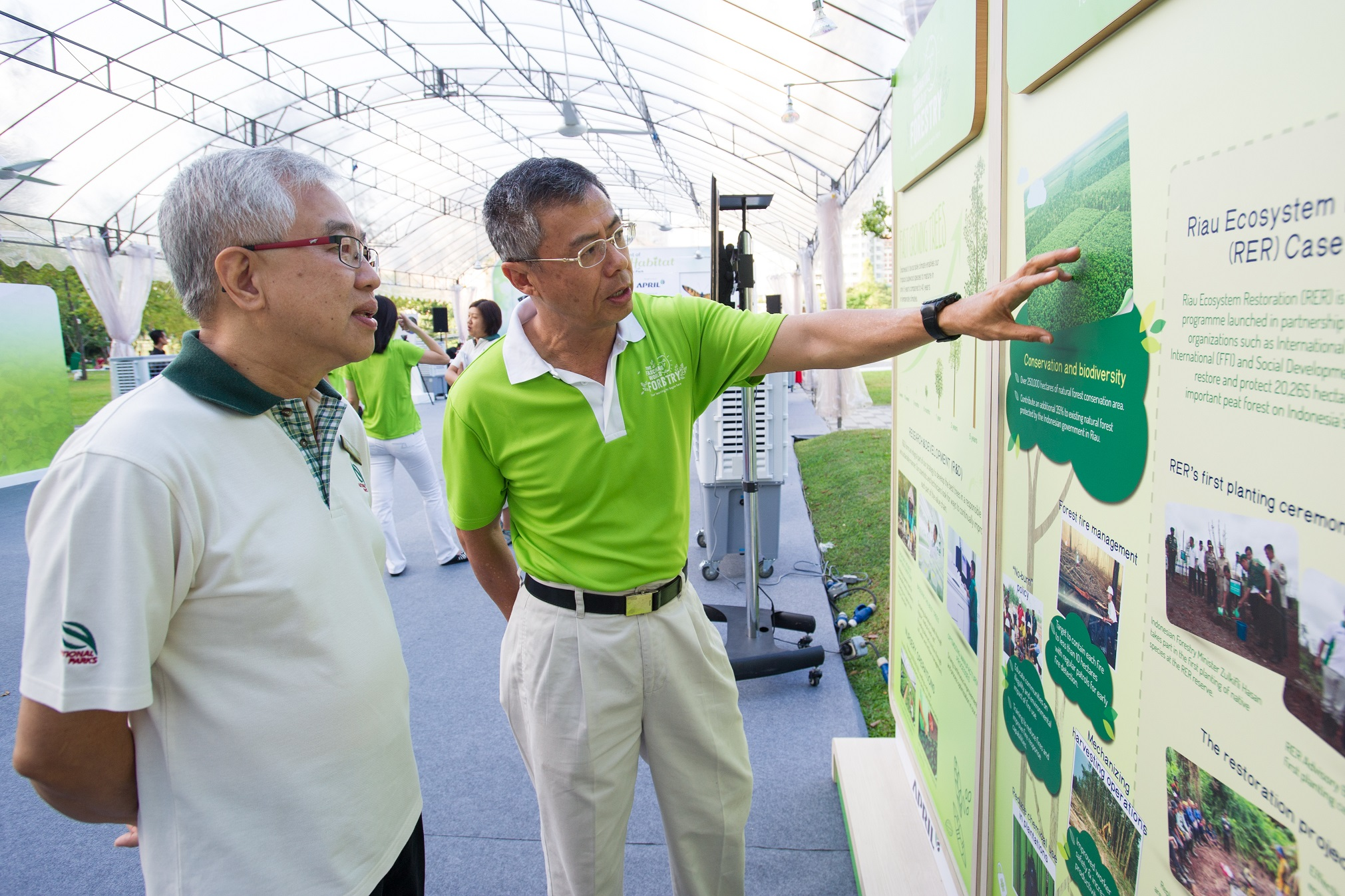 APRIL Group Chairman Bey Soo Khiang (right) shares APRIL's robust conservation and eco-restoration programmes with NParks' Assistant CEO Kong Yit San (left).