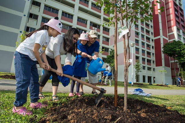 Tree planting is made a family affair at Bishan-Ang Mo Kio Park.