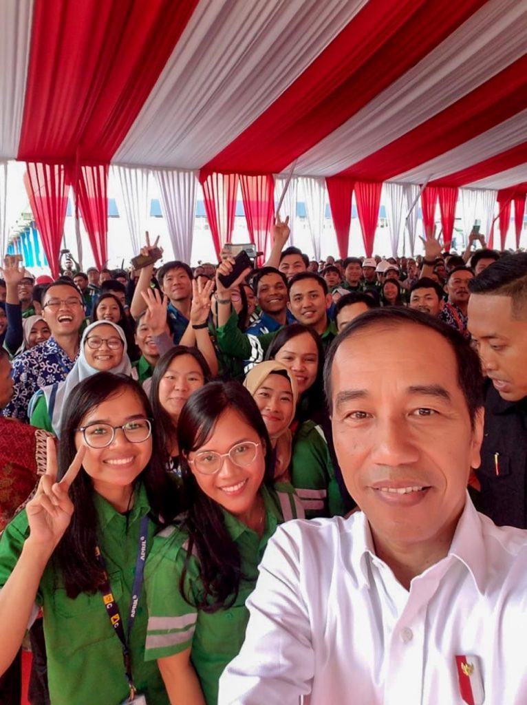 President Joko Widodo takes wefie to capture a historical moment with employees of Asia Pacific Rayon and APRIL Group
