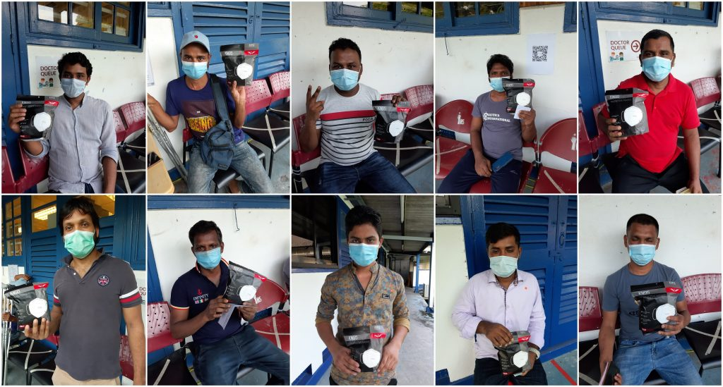 Singapore Migrant Workers with KN95 Masks donated by Tanoto Foundation